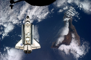 Space shuttle Atlantis docking over Tenerife