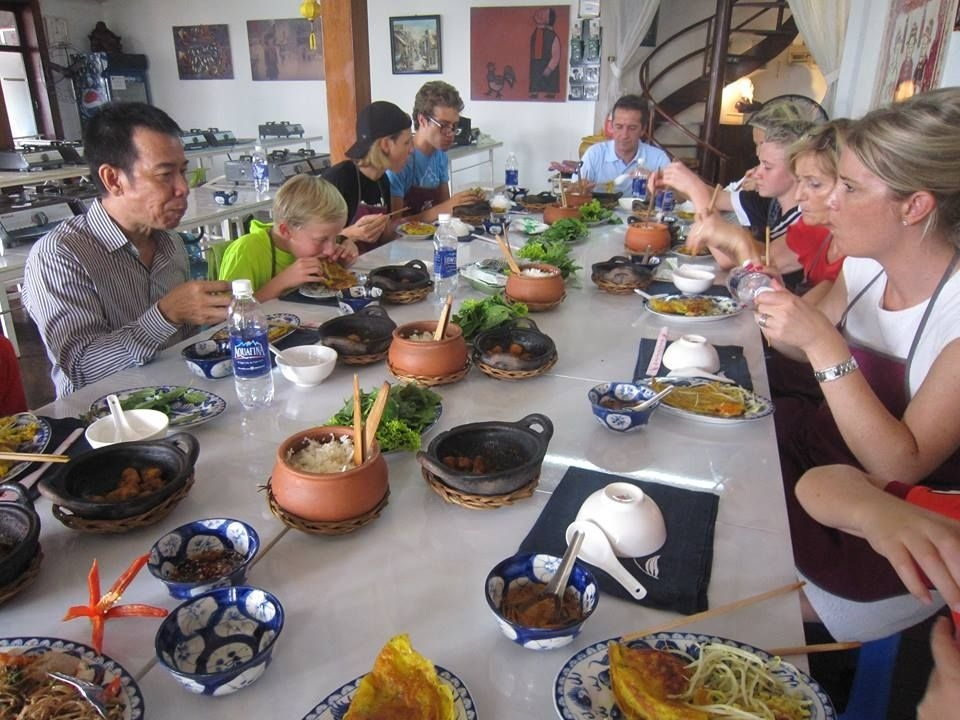 Tourists are having lunch together with everything they cooked
