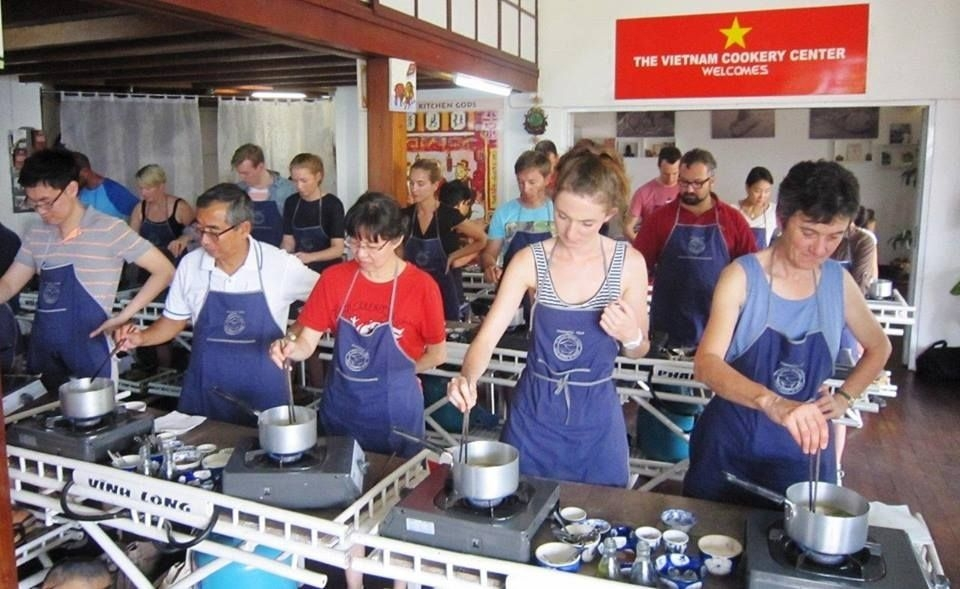 Everybody is concentrating on frying spring rolls