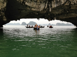 Boats Traveling Through Halong Bay Tunnel