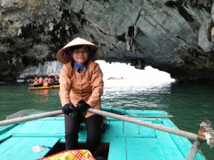 Girl Rowing Boat in Halong bay