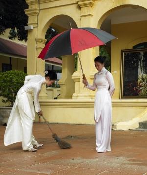 Hanoi Girls Sweeping Under the Sun