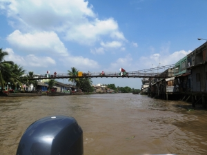 Motorbike Driving on Wooden Bridge at Mekong River